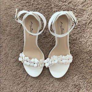 Anne Michelle white high heeled sandal.